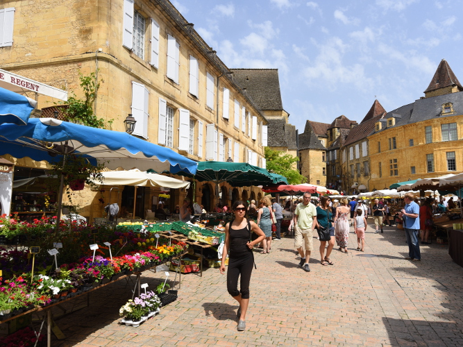 The Wednesday and Saturday markets at Sarlat with its hustle and bustle and local gourmet specialities (but get there early as the traffic can be bad).  The architecture of the old town is exceptional with many alleyways and cafes in secluded spots to explore