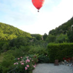 Hot air balloon over the garden