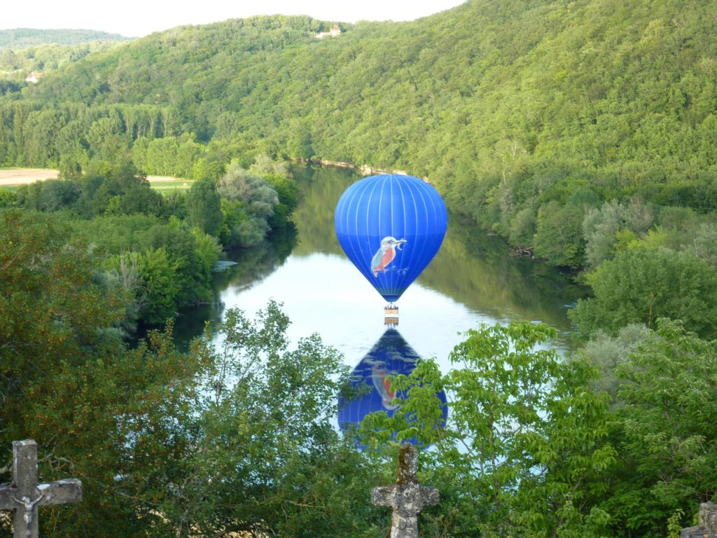 Balloon almost touching down in the river